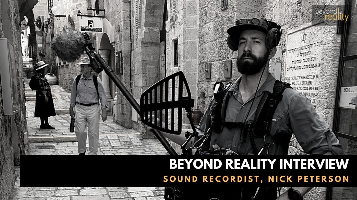Sound recordist holding boom microphone